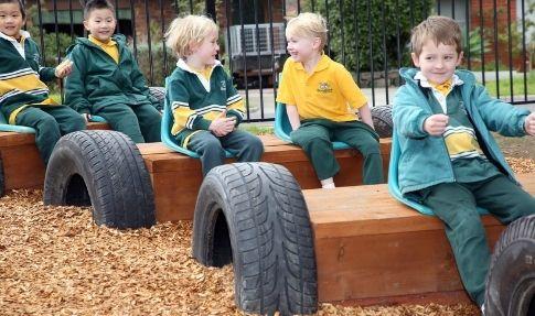 Bundoora Primary School - children pretending to drive in playground